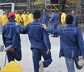 Workers stretching at a construction site