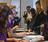 Students registering for the conference