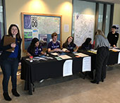 FIMS staff and student ambassadors at the registration table.